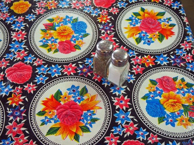 Black oil cloth with floral circles