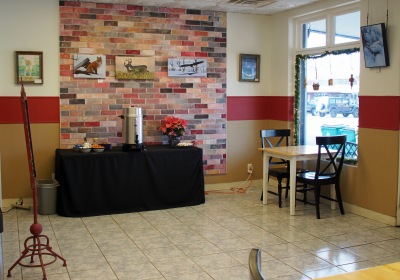 The self serve coffee area is to the right as you come in the door near the reading nook.
