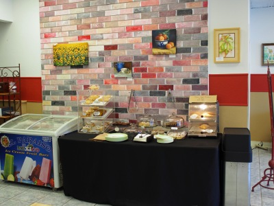 The self serve pastry area near the counter. We enjoyed the art displayed throughout the cafe. We especially liked the one with the peaches, which you can see in this photo.