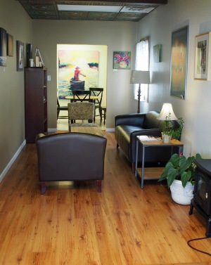 The room that I call the reading nook at The Bean & Biscuit. You can see another small room and table to the back.