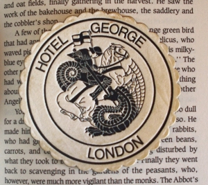 I found this paper coaster from the Hotel George, London in between the pages of the book.